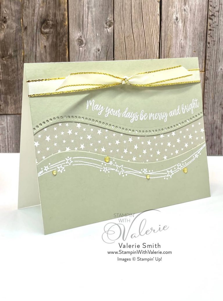 christmas card with stars and ribbon