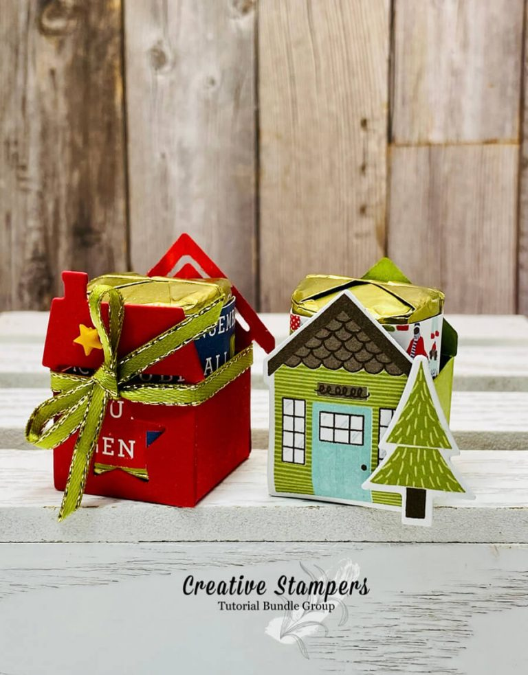 two mini paper houses with candy